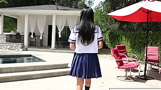 Schoolgirl Marica walks through the house before