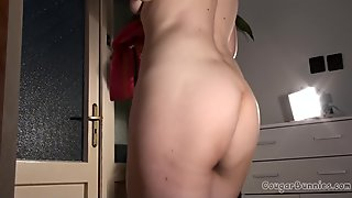 Mature Doris Dawn takes off her cloth and shows her hairy cunt