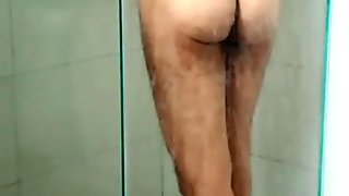 Spying a man taking a shower. What a beautiful ass!
